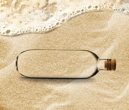empty Bottle in the beach sand with copy space to add your message inside the Bottle. photo