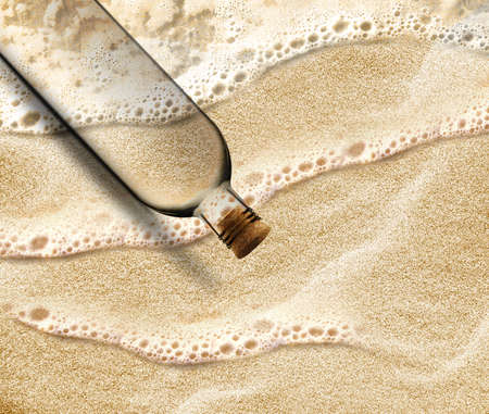 empty Bottle in the beach sand with copy space to add your message inside the Bottle. Stock Photo