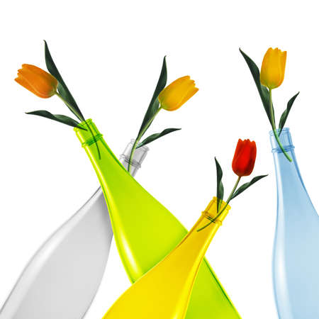 colored empty glass bottles and tulips on white background. photo