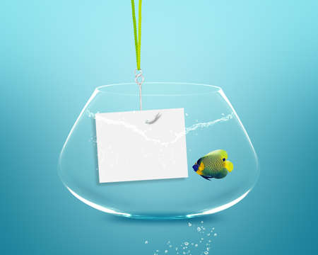 Anglefish in fish bowl with fishhook and note paper. photo