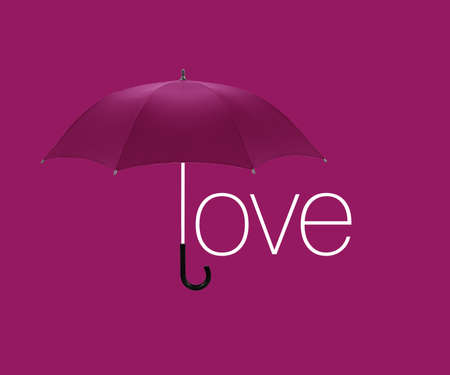 Umbrella inscription  love  on pink  background. photo