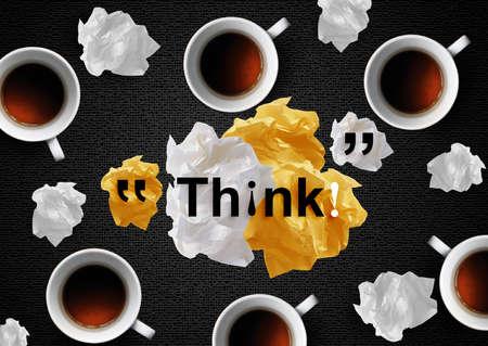 imaginary dialogue: Arrugados papeles coloridos con caf� en el escritorio negro.