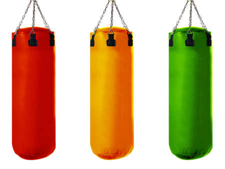 Punching bag for boxing or kick boxing sport, isolated on white background. photo