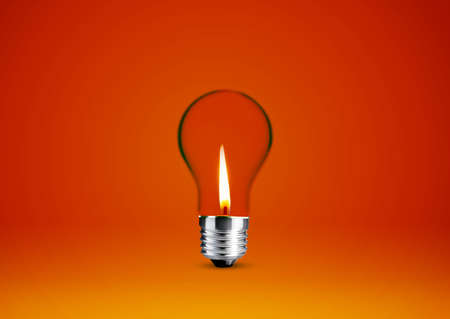 Wax candle into lighting bulb . photo