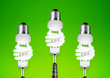 catchy: energy saving lightbulb on fork. Stock Photo