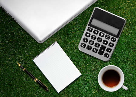 envelops: business desktop with laptop, notepad, calculator, envelops and coffee Stock Photo