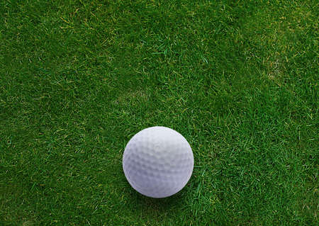 Golf ball on green grass land .  Stock Photo - 15551326