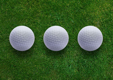 Three golf ball on green grass land . Stock Photo - 15551316