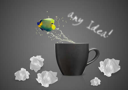 Angelfish jumping out of cup with water splashes and Acrobatic movement. Stock Photo - 15787246