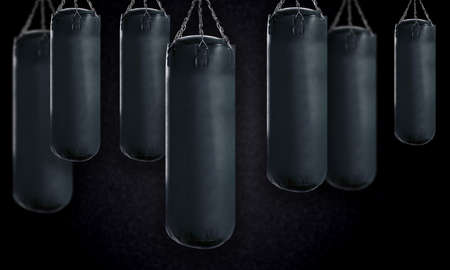 black Punching bag for boxing or kick boxing sport. photo