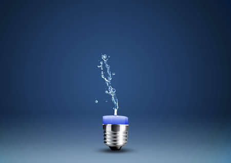 Wax candle into lighting bulb with water splashes.  Stock Photo - 15787104
