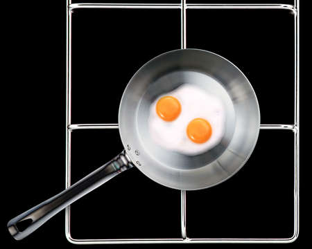 Frying pan with Fried eggs . photo