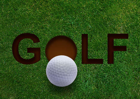 golf swings: Golf word on green grass and golf ball on lip of hole Stock Photo