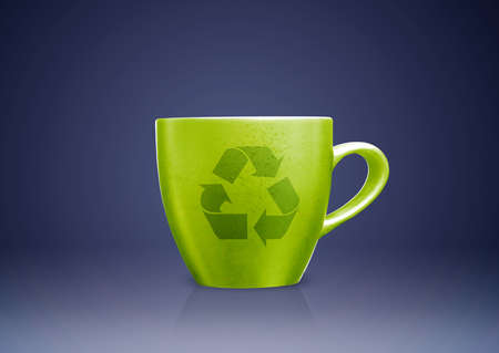 Green tea mug or cup with recycle sign on it, environmental conceptual image. Stock Photo - 15787248