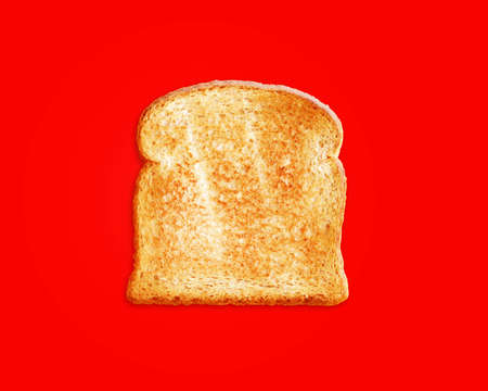 toasted bread slices for breakfast isolated on red background. photo