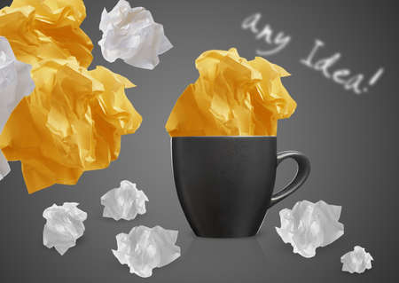 imaginary dialogue: Crumpled colorful papers with coffee on black desktop.