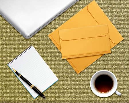 envelops: business desktop with laptop, notepad, envelops and coffee