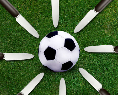 catchy: Football sport, soccer ball on grassland and knife around.