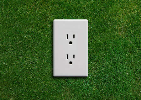 electricity  adapter on a green grassland, Green energy concept, Green power. photo