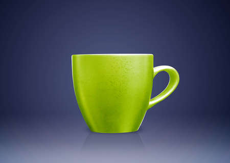 masterly: Green tea mug or cup on blue background.