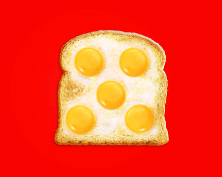 yolk: fried egg with toast on a Red background,