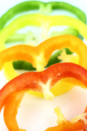 slices of colorful sweet bell pepper on white background  photo