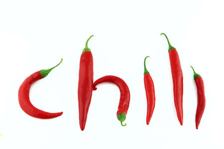 red chilly: red hot chili pepper on a white background  Stock Photo