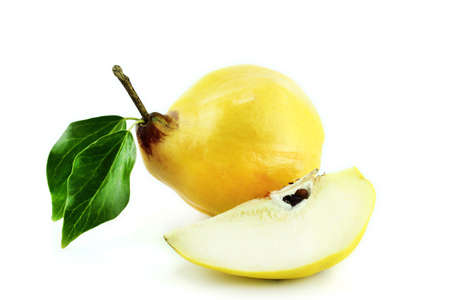 bitter fruit: sweet quinces with leaves and slice on white  Stock Photo