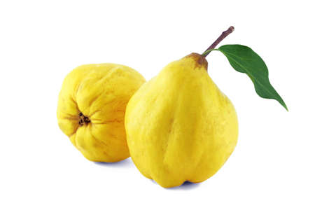 sweet quinces with leaves and slice on white  with a clipping path