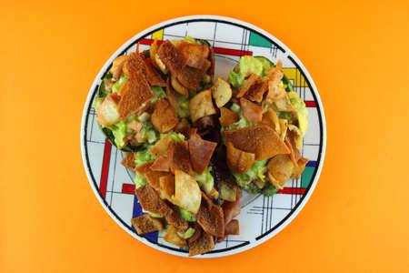 Healthy Avocado Salad stuffed with Crispy bread, tomato and salsa photo