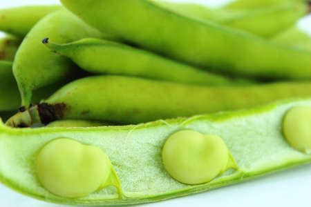 broad bean pods and beans on white background . Zdjęcie Seryjne - 20676988