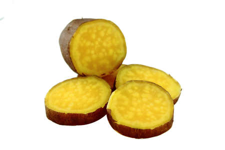 cutting sweet potatoes on white background photo