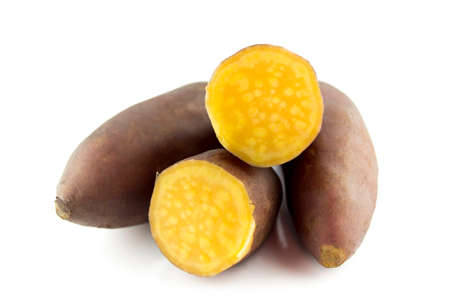 tuber: cutting sweet potatoes on white background  Stock Photo