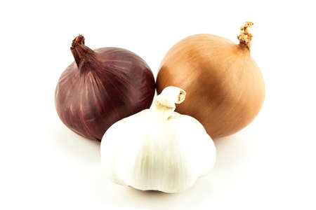 onion peel: Ripe golden, white onions and Garlic on white background.  Stock Photo