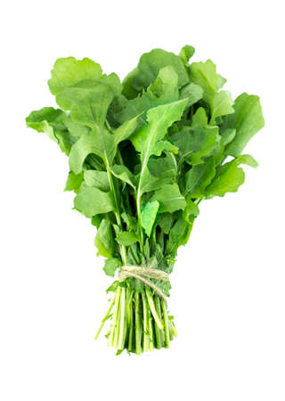 Green Rocket or Roquette leaves isolated on white background   photo