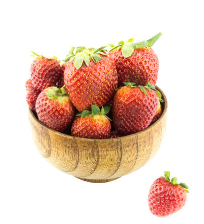Strawberries into wooden bowl isolated over white background  photo