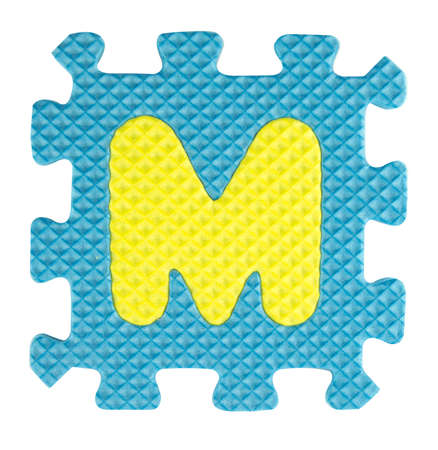M letter, Alphabet puzzle isloated on white background , with clipping path. photo