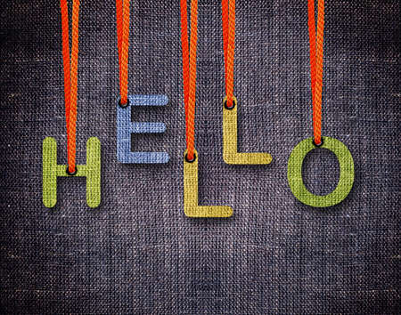 Hello Letters hanging strings with blue sackcloth background. photo