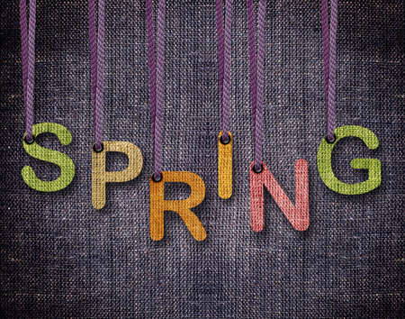 Spring letters hanging strings with blue sackcloth background. Stock Photo - 23518580