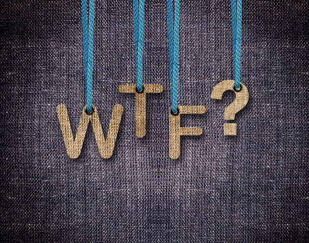 wtf: WTF Letters hanging strings with blue sackcloth background.