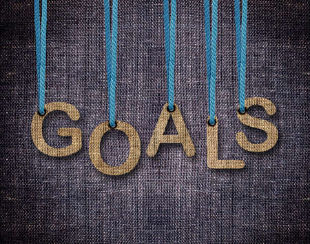 Goals Letters hanging strings with blue sackcloth background. Stock Photo - 23518602