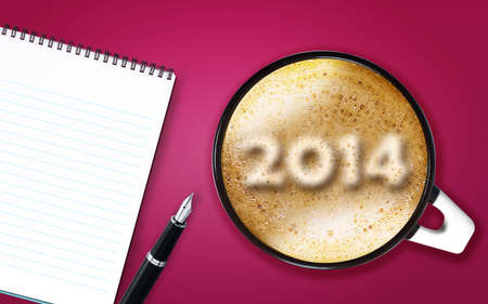 Happy new year 2014, cup of cappuccino with 2014 numbers made from foam with notepad and pen. photo