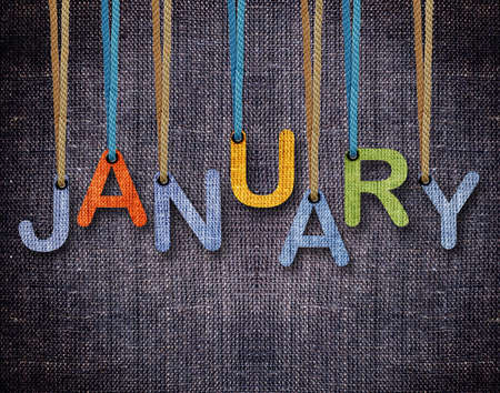 January letters hanging strings with blue sackcloth background. photo