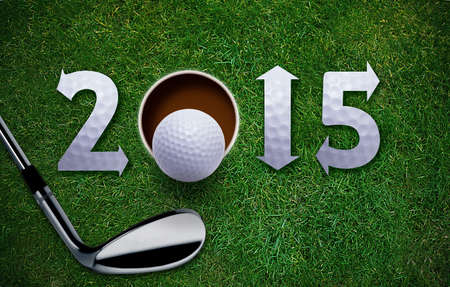 Happy New Golf year 2015,  Golf ball and putter on green grass, the same concept available for 2016 and 2017 year. Stock Photo