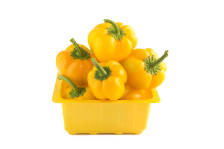 Sweet Yellow pepper in yellow box on a white.  photo
