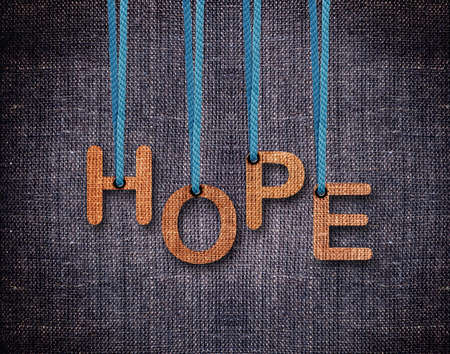 hope sign: Hope Letters hanging strings with blue sackcloth background.