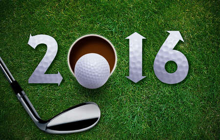 new designs: Happy New Golf year 2016,  Golf ball and putter on green grass, the same concept available for 2017 year. Stock Photo