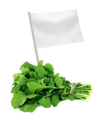 roquette: Healthy and organic food concept. Fresh Green Rocket or Roquette leaves with flag showing the benefits or the price of fruits.