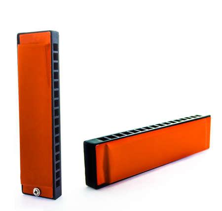 aerophone: Orange Harmonica On a White background