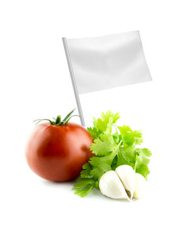 Healthy and organic food concept. Fresh Tomato, garlic and Coriander with flag showing the benefits or the price of fruits. photo
